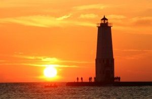 Sunset at Frankfort North Light House, located in Benzie county. See suggestions for a scenic summer drive to this photogenic lighthouse and five other great road trips: http://www.michigan.org/blog/guest-blogger/six-scenic-drives-for-pure-michigan-summer-road-trips/