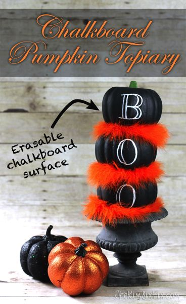 A simple stacked dollar store pumpkin topiary: Chalkboard Painted Dollar Store Pumpkins and an Orange Feather Boa combine to make this fabulous halloween themed black and orange topiary