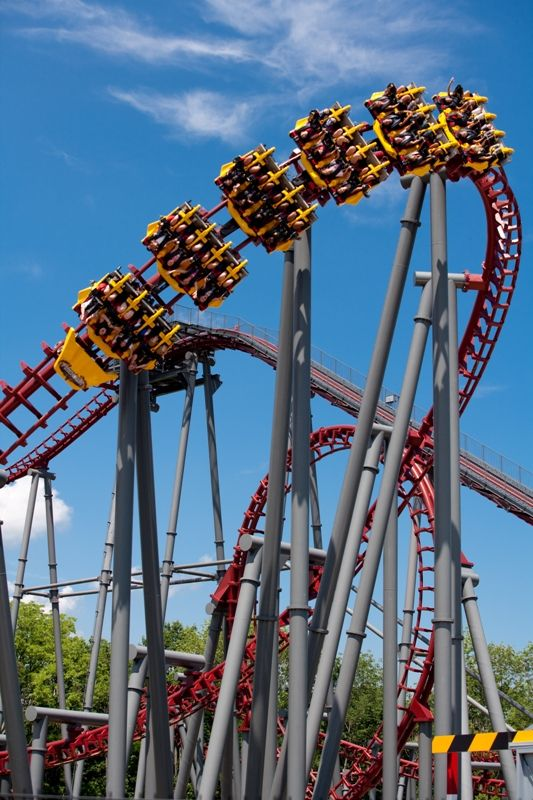 Firehawk at King's Island. You have no sense of direction, because you're laying on your back. Its pretty scary cause it feels like you are about to fall whey you face the ground! Its fun but a very long line!