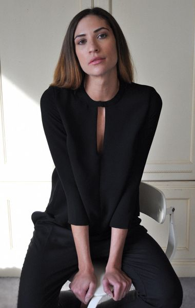 Rachel Comey Harbinger Top Sleek blouse in lightweight woven crepe.  Keyhole opening at neckline with hook and eye closure. 3/4 length sleeves. Rectangular cut-out detail at back hem. Made in New York.