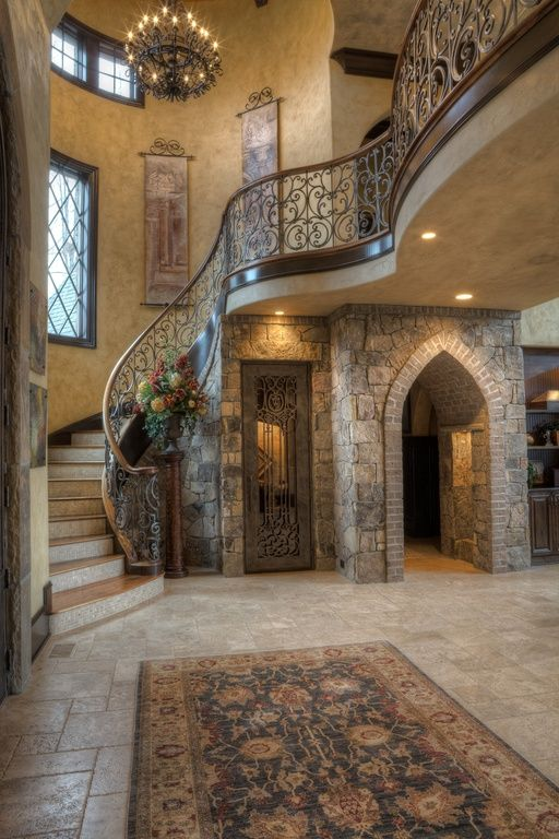 Mediterranean House Foyer : Mediterranean entryway with exposed beam hanging tapestry