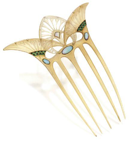 Egyptian theme carved hair comb in blonde tortoiseshell. Dotted by opals and accented with black and green enamel, the comb is signed G. Fouquet.
