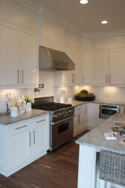 Brick backsplash white kitchen updating cabinets for Update white kitchen cabinets