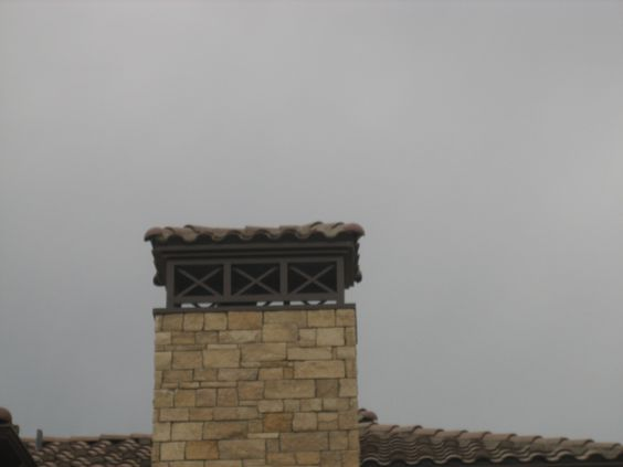 Hacienda style chimney crown in aged bronze with clay tile roof ...