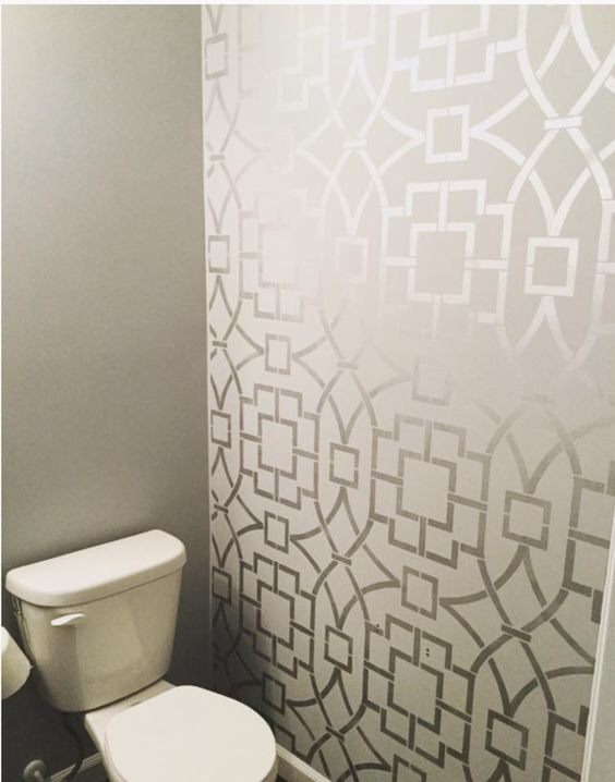 This Tea House Trellis wall pattern from Cutting Edge Stencils completely transforms this half bath!!! Makes quite the statement with the silver on grey http://www.cuttingedgestencils.com/tea-house-trellis-allover-stencil-pattern.html