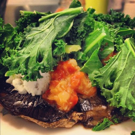 portobella mushroom with goat cheese, roasted red pepper and artichoke spread and kale on top