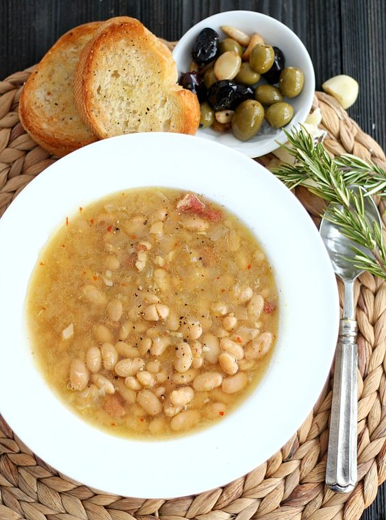 Tuscan White Bean Soup in the slow cooker is simple but bursting with ...