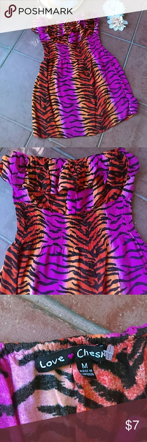 Animal Print Mini Dress sz M Bold animal print mini dress by Love Chesley, sz M. Never worn but tags missing. You can see the plastic on the tag where they were. Maybe a beach cover-up? Features elastic waist. Flirty! 100% Cotton. Machine wash. Love Chesley Dresses Strapless