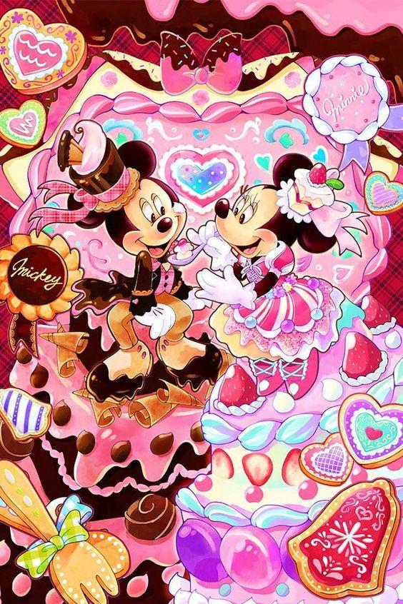 スイーツにかこまれるミッキーマウスとミニーマウス