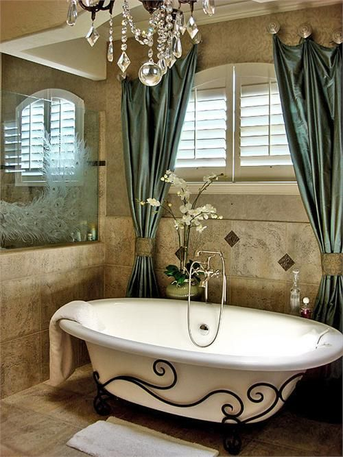 Check out the peacock on the glass. This bathroom is gorgeous.: