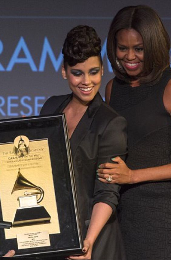 First Lady Of The United States  #MichelleObama Alicia Keys was among the honorees at the 2015 GRAMMYs on the Hill Awards on April 15, 2015 in Washington, D.C. First lady Michelle Obama presented the Recording Artists' Coalition Award to the 15-time GRAMMY winner.
