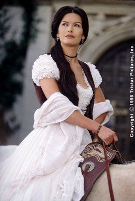 Cathrine Zeta Jones in the Mask of Zorro. I aspire to have hair like her in this movie