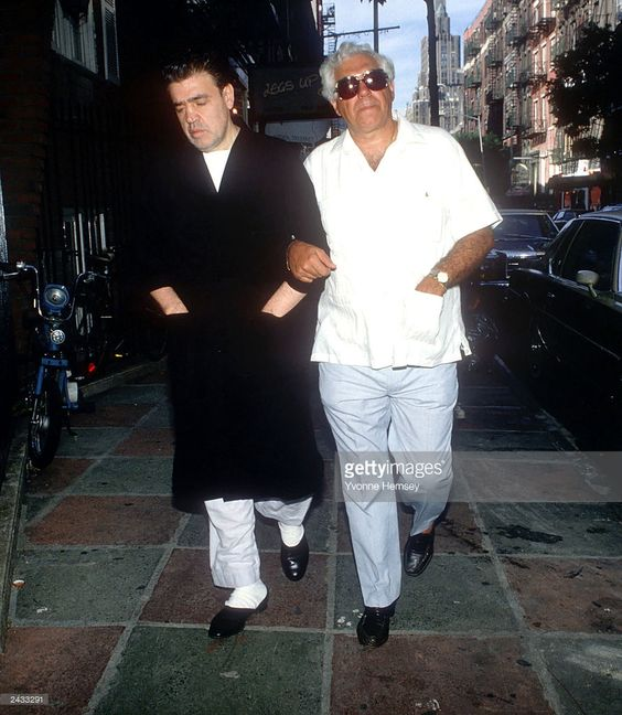 Godfather Vincente 'Chin' Gigante (L), Boss of the Genovese crime family, walks with his brother, Father Louis Gigante (a Roman Catholic priest) March 15, 1988 near his apartment in Greenwich Village in New York City. He is wearing his trademark bathrobe.