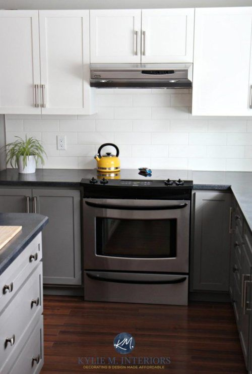 Dark Gray Lower Cabinets With A Speckled Black Countertop Keep This Kitchen Sleek And Sophistic Two Tone Kitchen Cabinets Two Tone Kitchen New Kitchen Cabinets