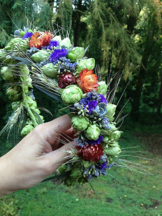 Vibrant, stunning! A hop flower crown with purple statice, orange straw flower, dried wheat and a few living succulents. Available fresh late