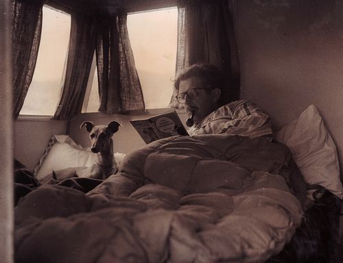 Jack reading in the caravan