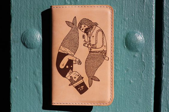 """""""Merpeople"""" leather cover for Moleskine - by Michael Hsiung."""