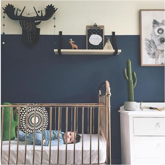 Gold crib and navy walls - an unusual and ecclectic nursery: