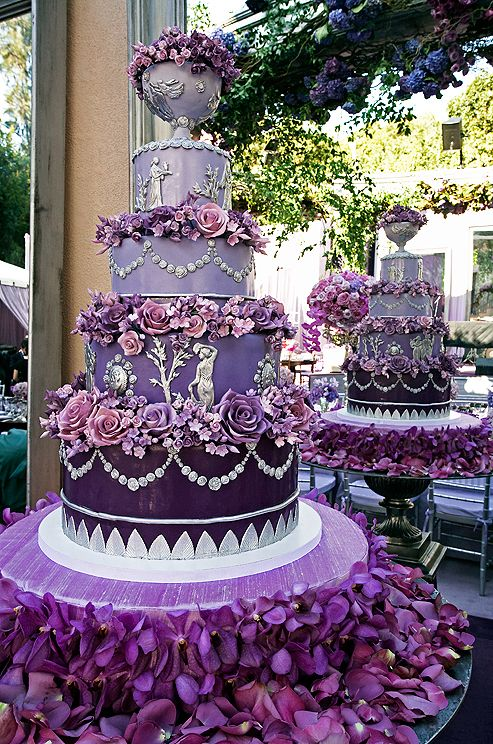 "No shade could possibly do this five-tier wedding cake with frieze-like architectural elements more justice than ""heraldic purpure."""