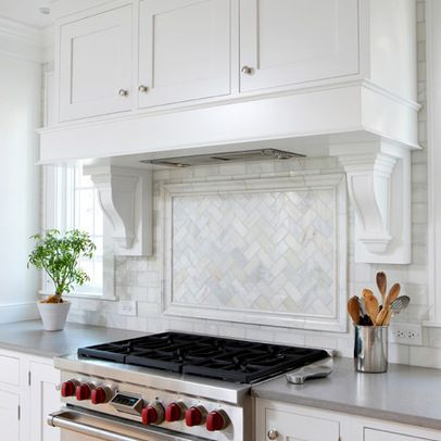 Backsplash · Carrara Marble in 3x6 subway with carrara herringbone pattern inlay above range