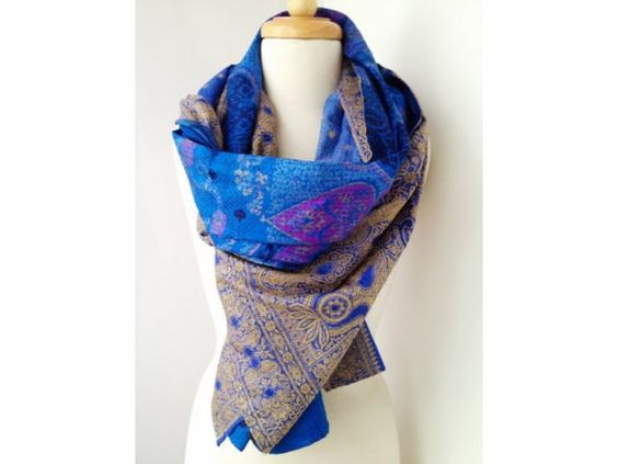 This one-of-a-kind scarf is handmade from vintage, upcycled saris. The scarf is made using two layers of fabric, handpicked for their fabulous colours and designs and matched in complementary colours.    These layers are stitched together in the traditional style of Indian kantha work, in which women hand sew rows of tiny running stitch from end to end to provide strength and enable the recycling of old saris.