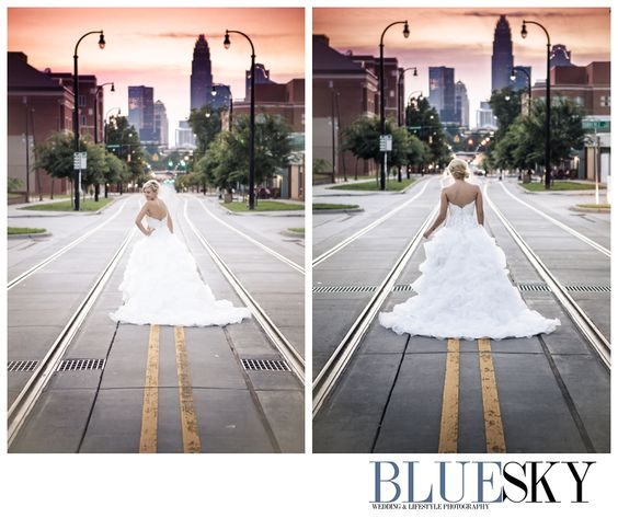 A sunset, city scape photo of this Charlotte bride shows off her dress and personality. BlueSky Studios Charlotte
