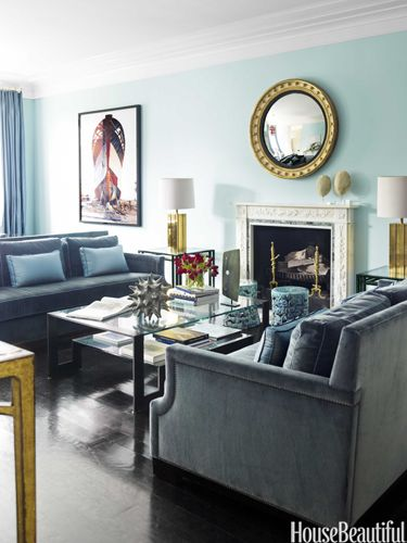 Blue living room. Design: Hillary Thomas and Jeff Lincoln. Photo: Eric Piasecki. housebeautiful.com. #living_room #blue #fireplace #velvet_sofa #coffee_table