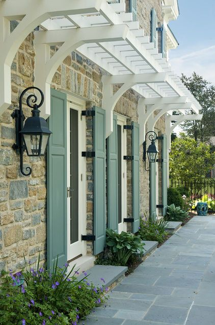 Trellis over front entrance would be great with fragrant flowers as you come into the home.
