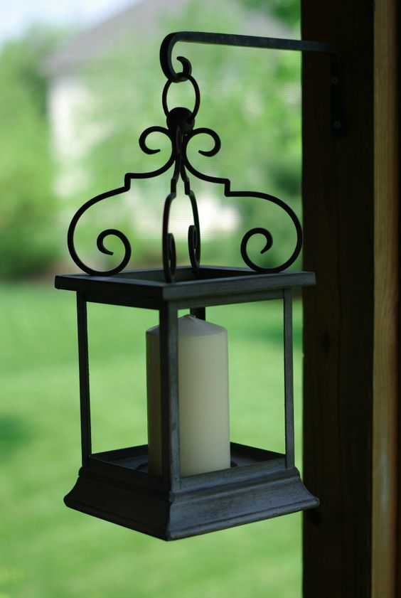 Screened Porch Decorating Ideas | Home & Plate | www.homeandplate.com | Hang lanterns to provide extra ambient lighting.