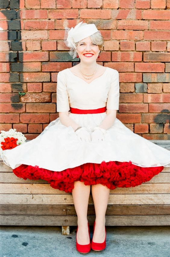 This makes me both happy and sad. Happy, because this bride is adorable and the crinoline is amazing. Sad, because I couldn't find those red shoes!