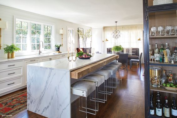 No uppers. Marble waterfall island. And is that a pull out, eating bar made of reclaimed wood? I hope so, cause I totally need it!