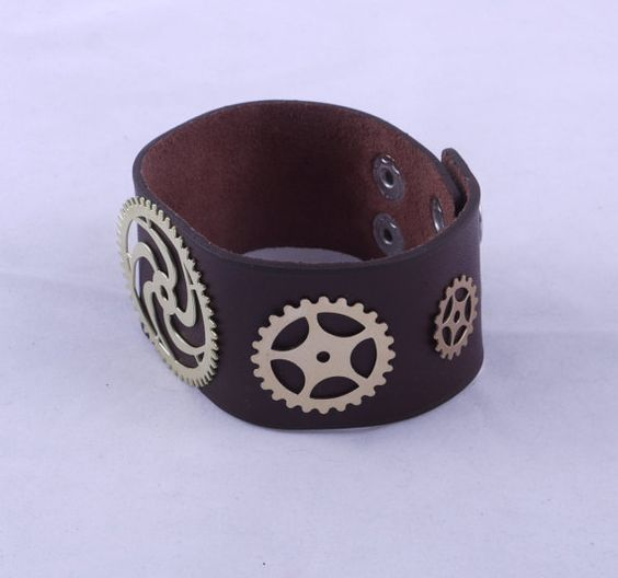 Steampunk Leather Bracelet / Steampunk Leather Bracer / Leather Bracelet / Leather Bracer  It has been said that when an arbitrary divine force offers one lemons, one should endeavor to make a citrus-based beverage from them. But what if one should find oneself swimming in spare parts from one's latest failed attempts work with battlefield-grade, clockwork automatons?*  In completely coincidental, fully-unrelated news, allow us to present to you our newest fashion statement!  ...