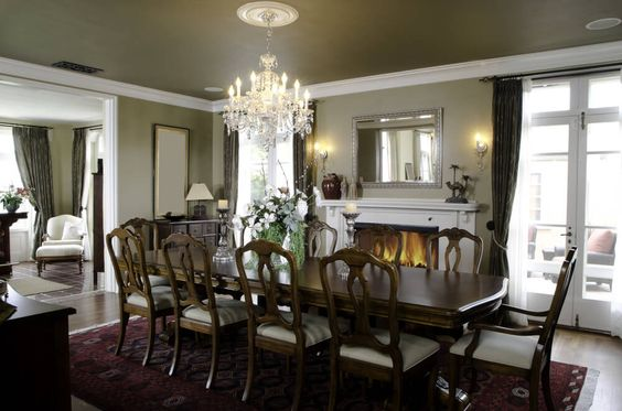 Large formal dining area with white fireplace on the long wall