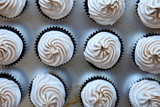 Chocolate cupcakes stuffed with chocolate chip peanut butter cookie dough topped with toasted marshmallow frosting. Oh yes. Might make these for my FIL's birthday.