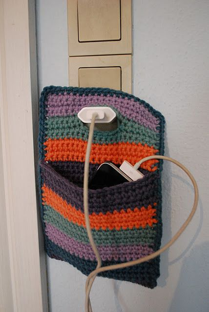 Holder for your mobile while charging... Made by Yarnfreak