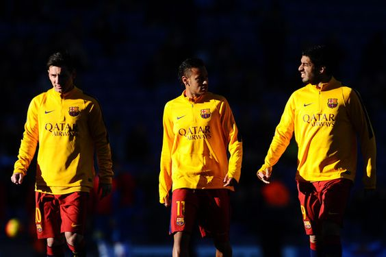(L-R) Lionel Messi, Neymar and Luis Suarez of FC Barcelona chat during the warm up prior to the La Liga match between RCD Espanyol and FC Barcelona at Cornella-El Prat Stadium on January 2, 2016 in Barcelona, Catalonia.