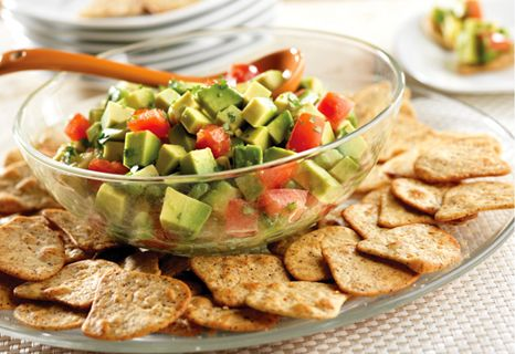 Spicy Avocado Dip - This refreshing party favorite is easy to make and bursting with flavor.  It's the perfect partner for baked tomato herb wheat crisps.