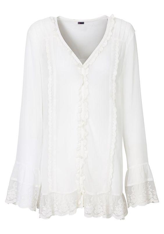 Bluse mit Biesen und Rüschenborte von Sheego Style @aboutyoude . Volants aus Spitze an Ärmeln und Saum. Größenangepasste Länge von ca. 72 bis 80 cm. Leicht transparente Qualität.