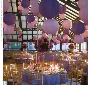 Varied heights and colors of hanging elements, like paper lanterns, add dimension and texture to reception spaces.  Photo: Courtesy of Michael Russo Events