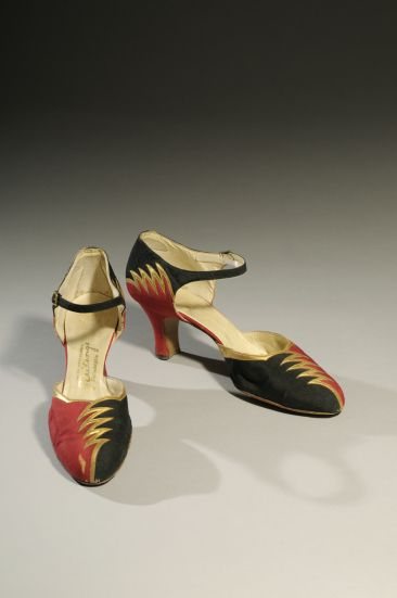 """1.A pair of black and red evening shoes with a """"lightning bolt"""" bolt motif from the late 1920s. The shoes of the 1920s are spectacular. Skirts were the shortest they had been for a millennium, so sheer stockings and flashy shoes were the latest fashion. The lightning bolt motif was fashionable in this period since it was associated with modern technology such as the telegraph and radio."""