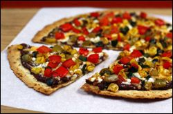 Mexicali Pizza  1 stick light string cheese  1/4 cup yellow corn   1/4 cup chopped red bell pepper   2 tbsp. chopped tomatillo  2 tbsp. chopped poblano pepper 1 medium-large high-fiber flour tortilla 3 tbsp. canned refried black beans  2 tbsp. no-salt-added tomato sauce   Dash cayenne pepper, or more to taste  Dash garlic powder, or more to taste  2 tbsp. shredded fat-free cheddar cheese