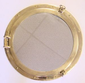 "20"" Solid-Brass Porthole Mirror to center on wall inside sailboat.  Maybe 2 swing arm (or not) sconces on each side with shades like the Sarah Richardson Pic."