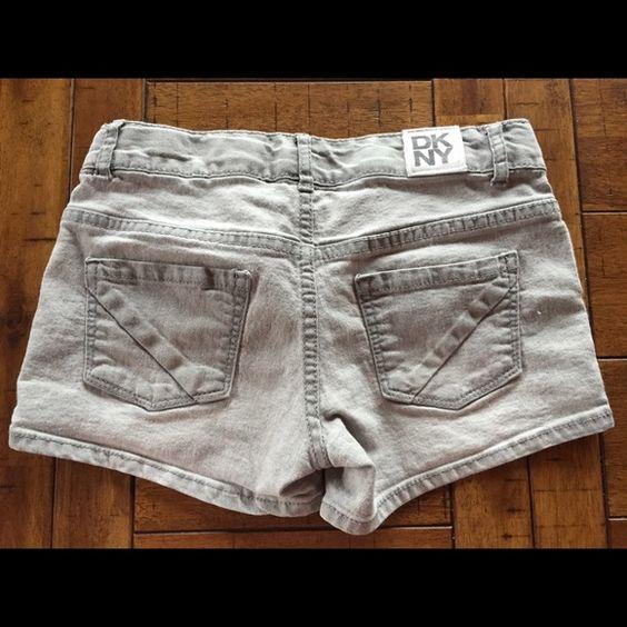 """Girls DKNY Shorts Grey 3"""" shorts Girls size 10.  Elastic straps in waste to tighten. DKNY Bottoms Shorts"""