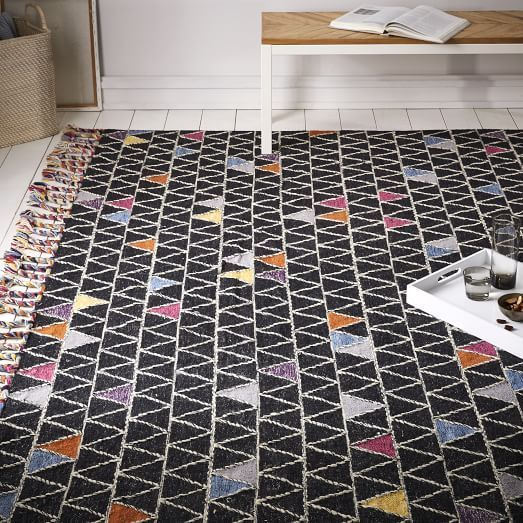 This black rug with colorful triangles adds a fun pattern to any room www.homeology.co.za