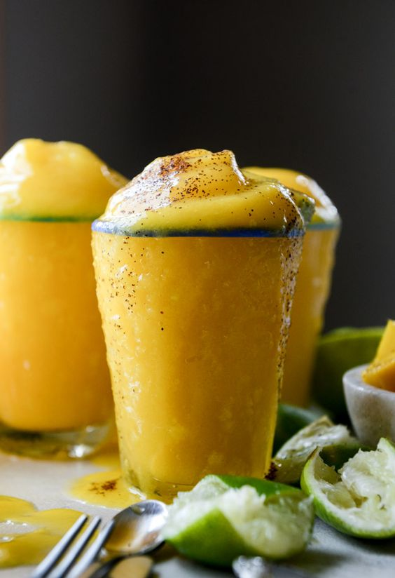 fresh mango margarita frosty made with fresh fruit, lime, tequila and a touch of grand marnier. @howsweeteats