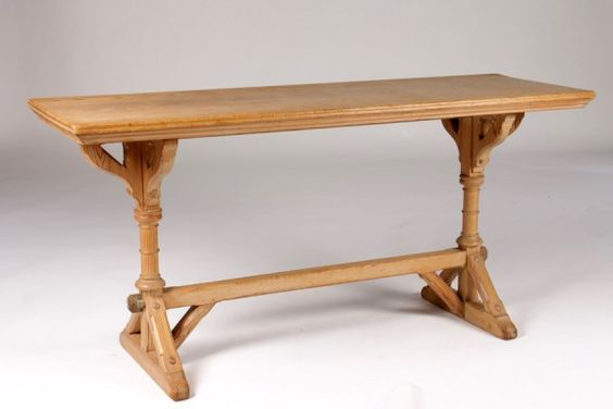 A 19th Century English Gothic Style Console Table.  Made of Pine with a lustrous pale golden patination.  The narrow molded top over a decorative turned trestle base with gothic arched supports and chamfered stretchers and feet.  Made in England circa 1870. #Hasteningdesignstuido $2900.00  #Gothic #Antique #Furniture #English #19thcentury