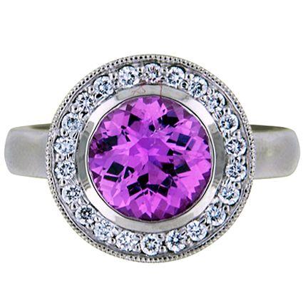 Custom Designed Sapphire Round Bezel Halo with Milgrain set with a glowing 7.5mm round pink Sri Lanka sapphire | brilliantearth.com
