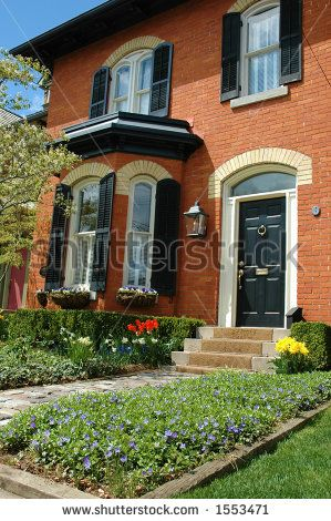 Stock photo red brick house with black shutters and pretty flower garden for the home - Red brick house black shutters ...