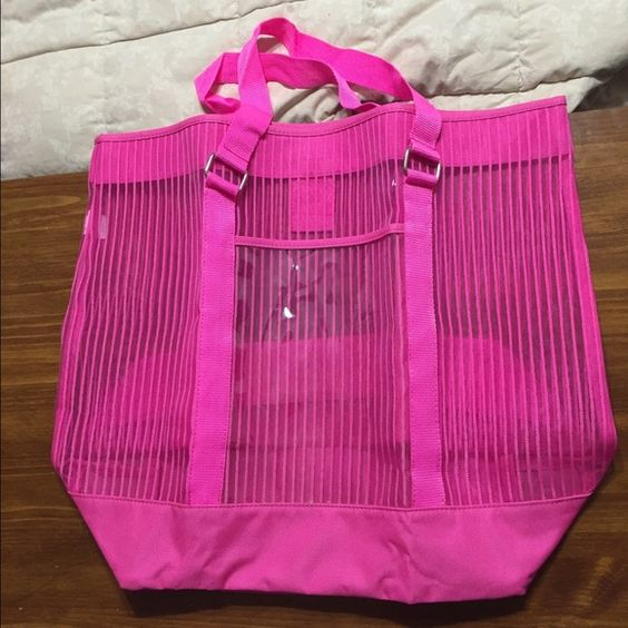 Large tote Large pink tote. Perfect for summer beach trips. Used once. Still like new. Perfect condition. Has a small front pocket on the outside of bag. Bags Totes