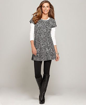 Tee under short sleeve sweater dress, leggings and boots.
